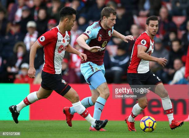 Chris Wood of Burnley takes on Cedric Soares and Maya Yoshida of Southampton during the Premier League match between Southampton and Burnley at St...