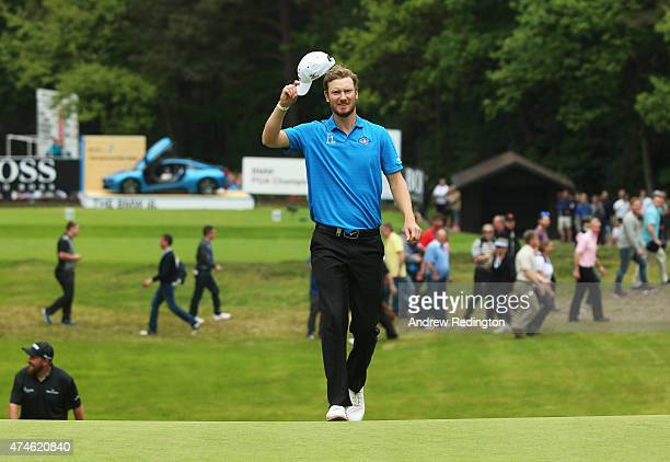 Chris Wood of England celebrates his holeinone on the 14th hole during day 4 of the BMW PGA Championship at Wentworth on May 24 2015 in Virginia...