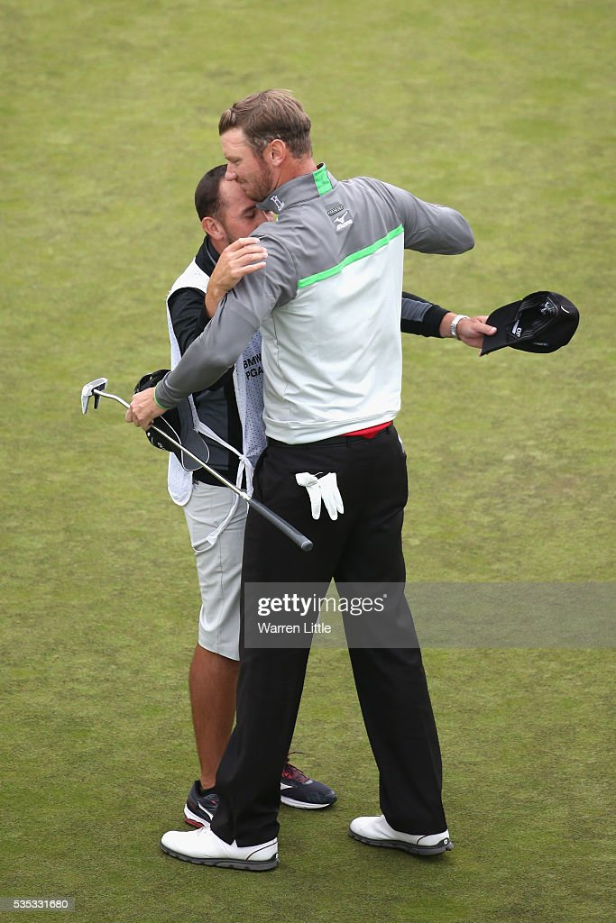 <a gi-track='captionPersonalityLinkClicked' href=/galleries/search?phrase=Chris+Wood+-+Golfer&family=editorial&specificpeople=4601133 ng-click='$event.stopPropagation()'>Chris Wood</a> of England celebrates victory on the 18th green with caddie Mark Crane during day four of the BMW PGA Championship at Wentworth on May 29, 2016 in Virginia Water, England.