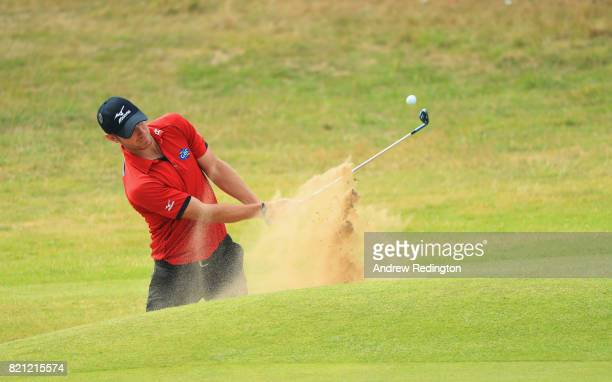 Chris Wood of England hits a bunker shot on the 18th hole during the final round of the 146th Open Championship at Royal Birkdale on July 23 2017 in...