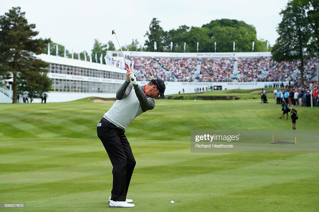 <a gi-track='captionPersonalityLinkClicked' href=/galleries/search?phrase=Chris+Wood+-+Golfer&family=editorial&specificpeople=4601133 ng-click='$event.stopPropagation()'>Chris Wood</a> of England hits his 2nd shot on the 18th hole during day four of the BMW PGA Championship at Wentworth on May 29, 2016 in Virginia Water, England.