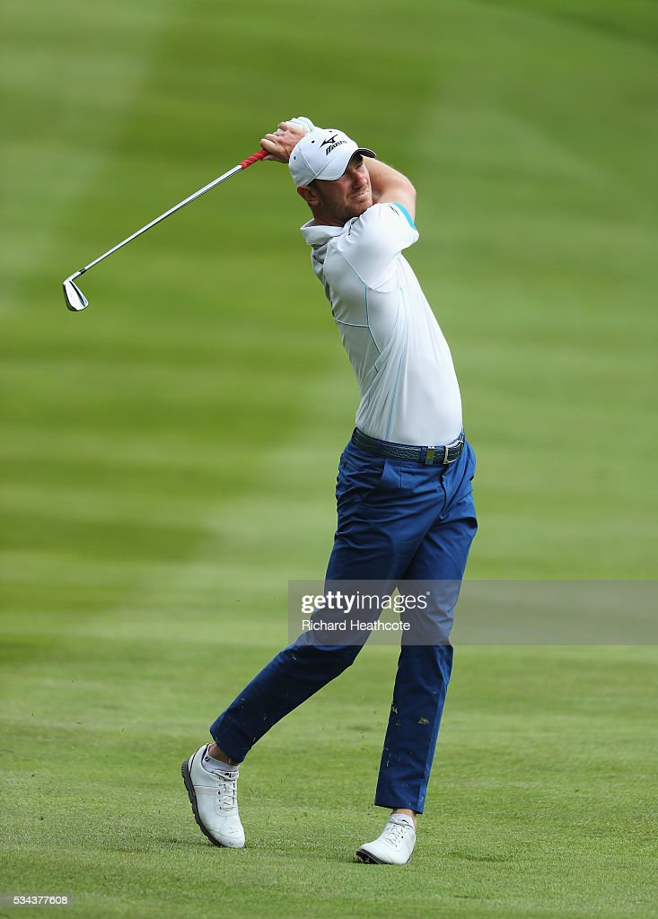 Chris Wood of England hits his 2nd shot on the 4th hole during day one of the BMW PGA Championship at Wentworth on May 26, 2016 in Virginia Water, England.