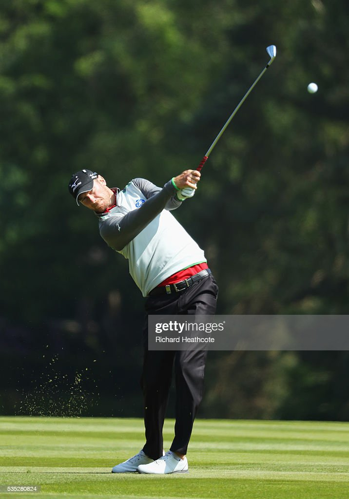 Chris Wood of England hits his 2nd shot on the 9th hole during day four of the BMW PGA Championship at Wentworth on May 29 2016 in Virginia Water...