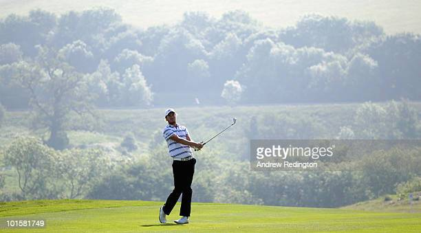 Chris Wood of England hits his second shot on the 16th hole during the first round of the Celtic Manor Wales Open on The Twenty Ten Course at The...