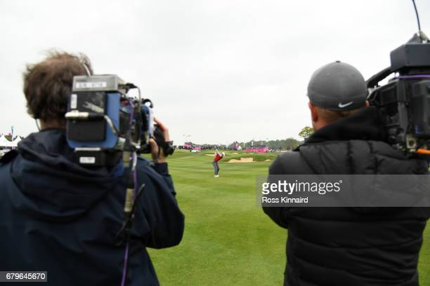 Chris Wood of England hits his second shot on the 6th hole filmed by TV Cameras during the Group A match between England and Netherlands during day...