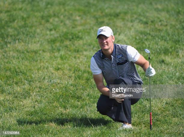 Chris Wood of England looks anxious after playing his approach shot on the 17th hole during the final round of the Sicilian Open at Verdura Golf and...