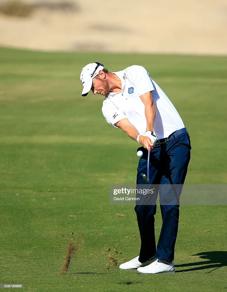 <a gi-track='captionPersonalityLinkClicked' href=/galleries/search?phrase=Chris+Wood+-+Golfprofi&family=editorial&specificpeople=4601133 ng-click='$event.stopPropagation()'>Chris Wood</a> of England plays his second shot at the par 4, 14th hole during the third round of the 2016 Omega Dubai Desert Classic on the Majlis Course at the Emirates Golf Club on February 6, 2016 in Dubai, United Arab Emirates.