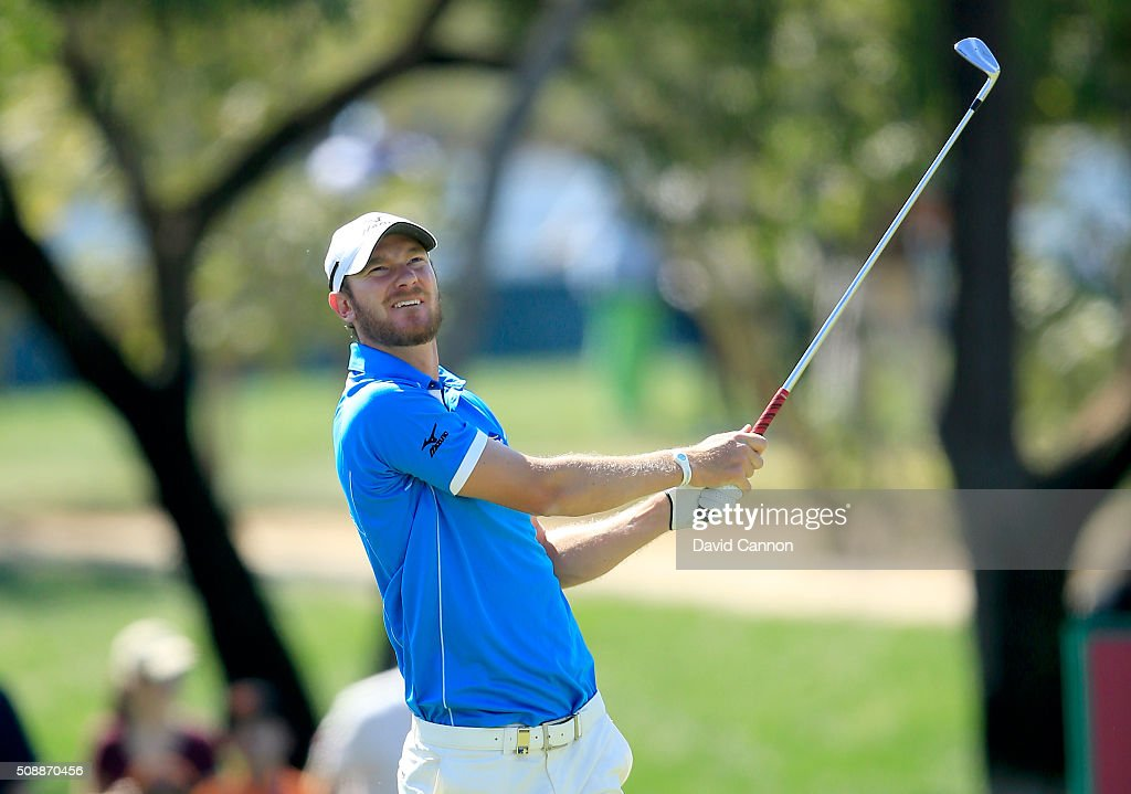 <a gi-track='captionPersonalityLinkClicked' href=/galleries/search?phrase=Chris+Wood+-+Golfer&family=editorial&specificpeople=4601133 ng-click='$event.stopPropagation()'>Chris Wood</a> of England plays his second shot at the par 4, first hole during the final round of the 2016 Omega Dubai Desert Classic on the Majlis Course at the Emirates Golf Club on February 7, 2016 in Dubai, United Arab Emirates.
