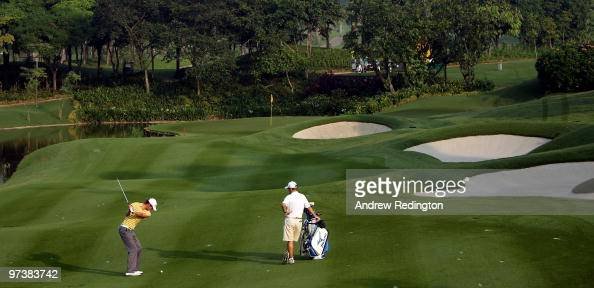 Chris Wood of England plays his second shot on the 16th hole during practice prior to the start of the Maybank Malaysian Open at the Kuala Lumpur...