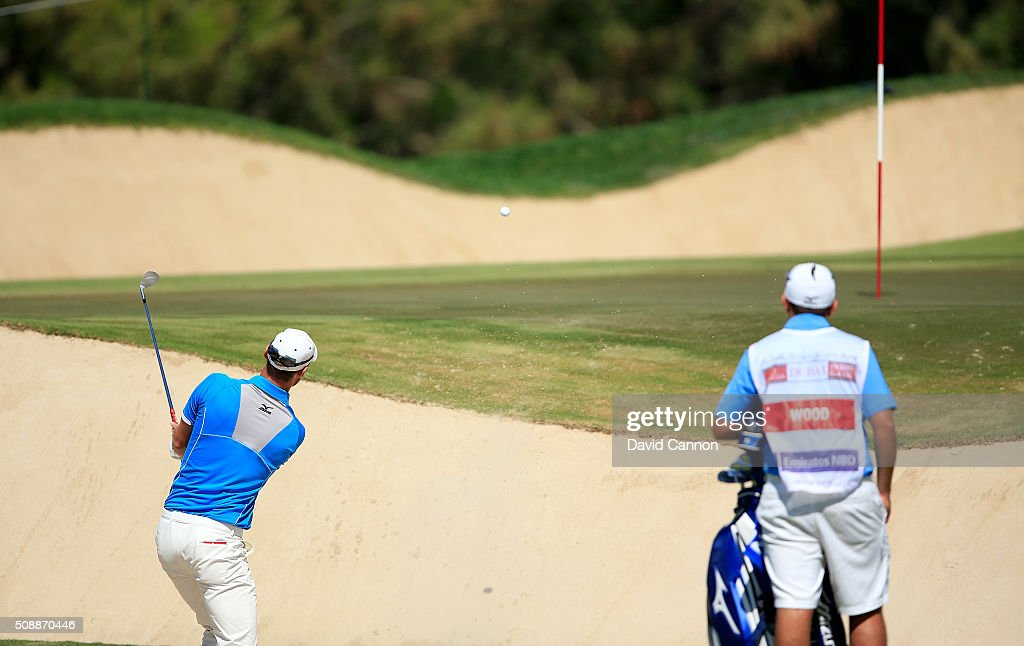 <a gi-track='captionPersonalityLinkClicked' href=/galleries/search?phrase=Chris+Wood+-+Golfer&family=editorial&specificpeople=4601133 ng-click='$event.stopPropagation()'>Chris Wood</a> of England plays his third shot at the par 4, first hole during the final round of the 2016 Omega Dubai Desert Classic on the Majlis Course at the Emirates Golf Club on February 7, 2016 in Dubai, United Arab Emirates.