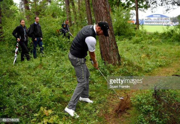Chris Wood of England plays his third shot from the ruff after dropping on the 18th hole during day four of the Nordea Masters at Barseback Golf...