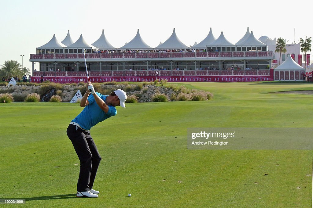 Chris Wood of England plays his third shot on the 18th hole during the third round of the Commercial Bank Qatar Masters held at Doha Golf Club on...