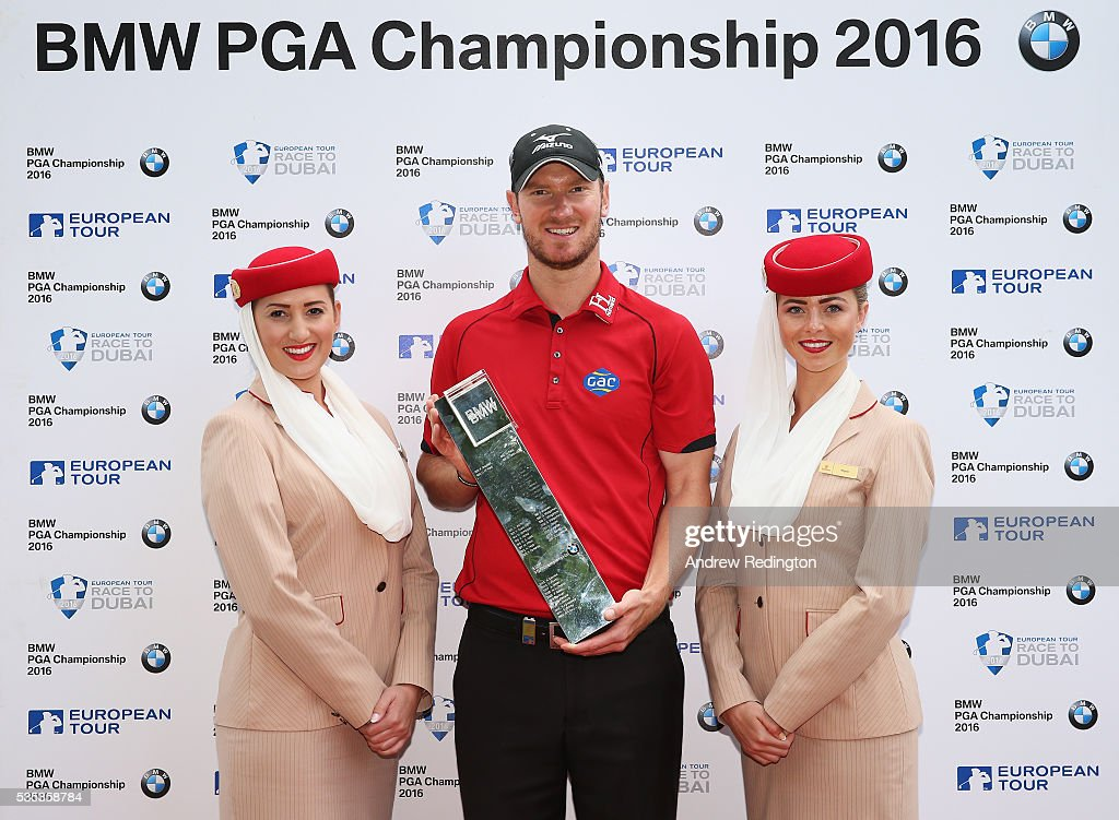 <a gi-track='captionPersonalityLinkClicked' href=/galleries/search?phrase=Chris+Wood+-+Golfer&family=editorial&specificpeople=4601133 ng-click='$event.stopPropagation()'>Chris Wood</a> of England poses with Emirates cabin crew and the trophy following his victory during day four of the BMW PGA Championship at Wentworth on May 29, 2016 in Virginia Water, England.