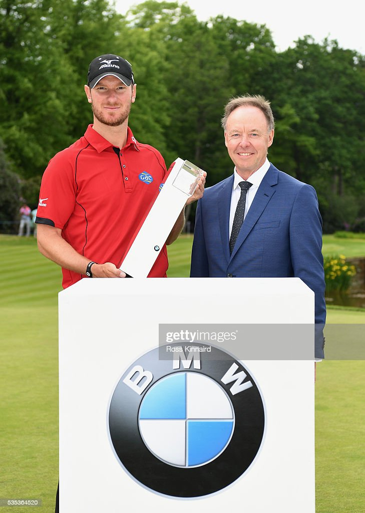 Chris Wood of England poses with the trophy and Dr Ian Robertson, Member of the Board BMW AG Sales following his victory during day four of the BMW PGA Championship at Wentworth on May 29, 2016 in Virginia Water, England.