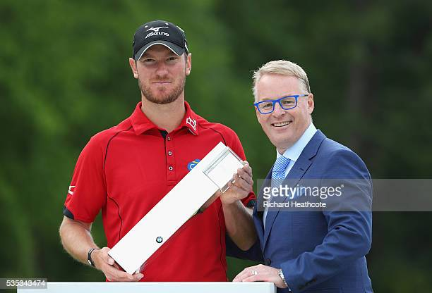 Chris Wood of England poses with the trophy and European Tour Chief Executive Keith Pelley following his victory during day four of the BMW PGA...