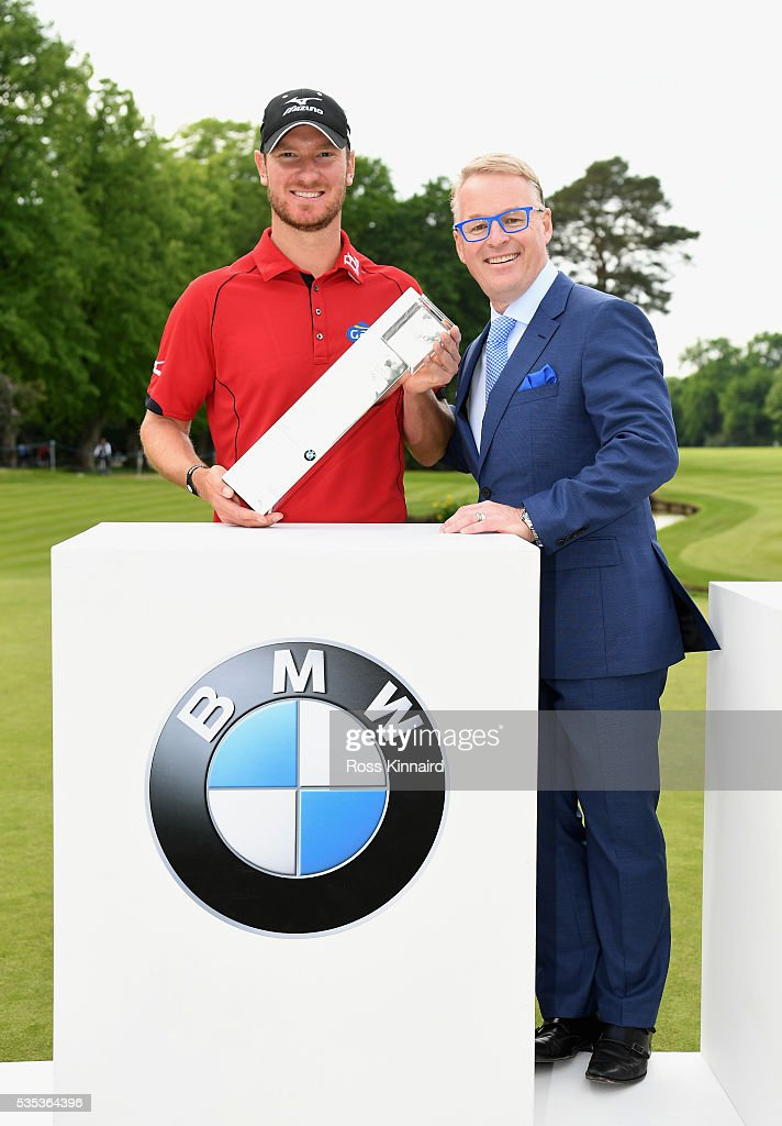 <a gi-track='captionPersonalityLinkClicked' href=/galleries/search?phrase=Chris+Wood+-+Golfer&family=editorial&specificpeople=4601133 ng-click='$event.stopPropagation()'>Chris Wood</a> of England poses with the trophy and European Tour Chief Executive <a gi-track='captionPersonalityLinkClicked' href=/galleries/search?phrase=Keith+Pelley&family=editorial&specificpeople=8533833 ng-click='$event.stopPropagation()'>Keith Pelley</a> following his victory during day four of the BMW PGA Championship at Wentworth on May 29, 2016 in Virginia Water, England.