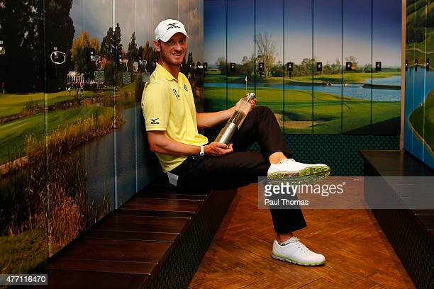 Chris Wood of England poses with the trophy during the Lyoness Open day four at the Diamond Country Club on June 14 2015 in Atzenbrugg Austria