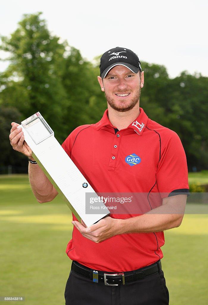 <a gi-track='captionPersonalityLinkClicked' href=/galleries/search?phrase=Chris+Wood+-+Golfer&family=editorial&specificpeople=4601133 ng-click='$event.stopPropagation()'>Chris Wood</a> of England poses with the trophy following his victory during day four of the BMW PGA Championship at Wentworth on May 29, 2016 in Virginia Water, England.
