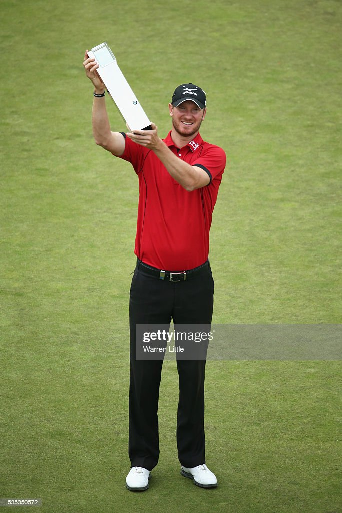 <a gi-track='captionPersonalityLinkClicked' href=/galleries/search?phrase=Chris+Wood+-+Golf&family=editorial&specificpeople=4601133 ng-click='$event.stopPropagation()'>Chris Wood</a> of England poses with the trophy following his victory during day four of the BMW PGA Championship at Wentworth on May 29, 2016 in Virginia Water, England.
