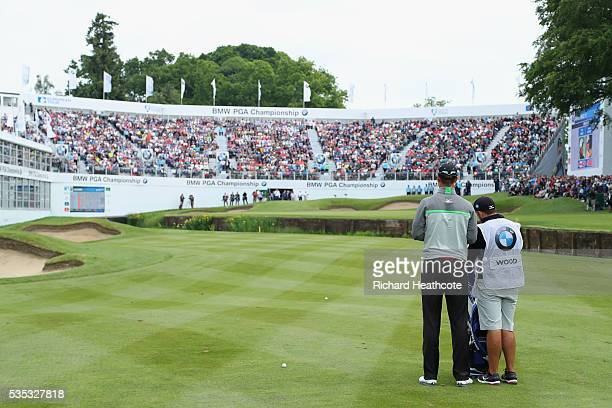 Chris Wood of England prepares to hit his 3rd shot on the 18th hole during day four of the BMW PGA Championship at Wentworth on May 29 2016 in...
