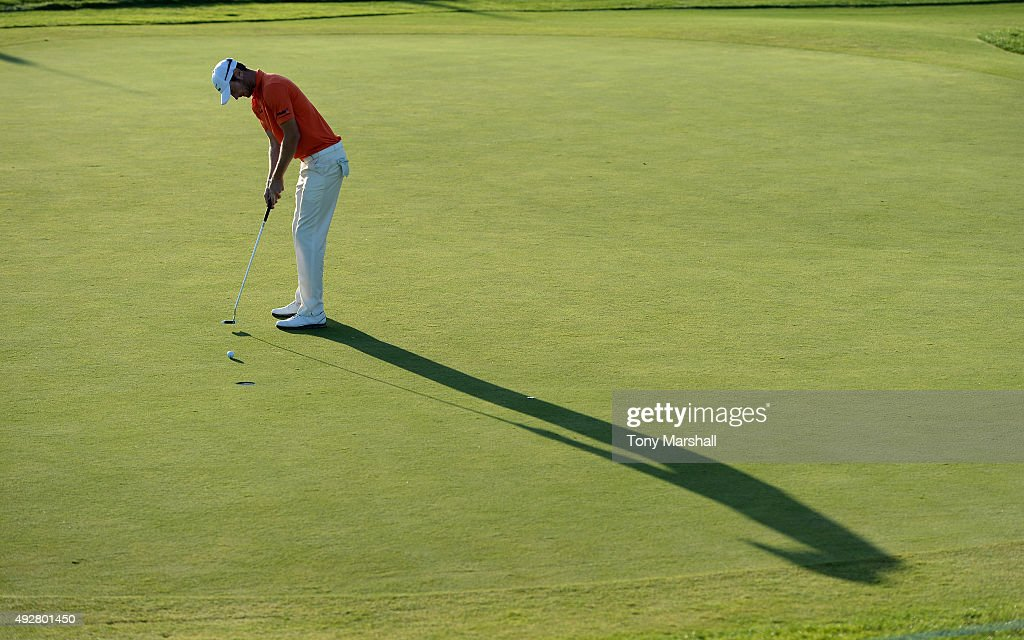 Chris Wood of England putts on the 16th green during the first round of the Portugal Masters at Oceanico Victoria Golf Club on October 15 2015 in...