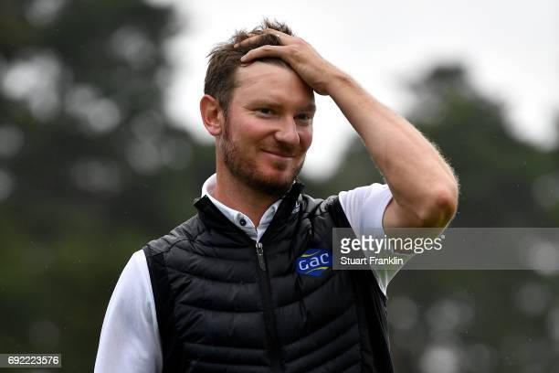 Chris Wood of England reacts as he leaves the 18th green during day four of the Nordea Masters at Barseback Golf Country Club on June 4 2017 in...