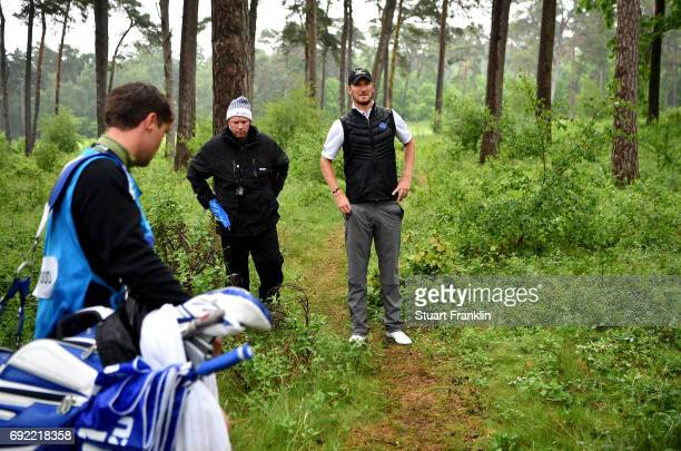 Chris Wood of England reacts to losing his ball in the trees on the 18th hole during day four of the Nordea Masters at Barseback Golf Country Club on...