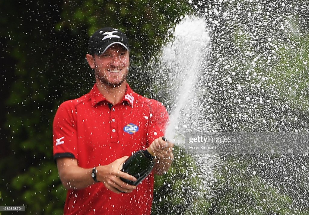 <a gi-track='captionPersonalityLinkClicked' href=/galleries/search?phrase=Chris+Wood+-+Golfer&family=editorial&specificpeople=4601133 ng-click='$event.stopPropagation()'>Chris Wood</a> of England sprays champagne following his victory during day four of the BMW PGA Championship at Wentworth on May 29, 2016 in Virginia Water, England.