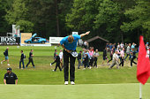 Chris Wood of England takes a bow as he celebrates his holeinone on the 14th hole during day 4 of the BMW PGA Championship at Wentworth on May 24...
