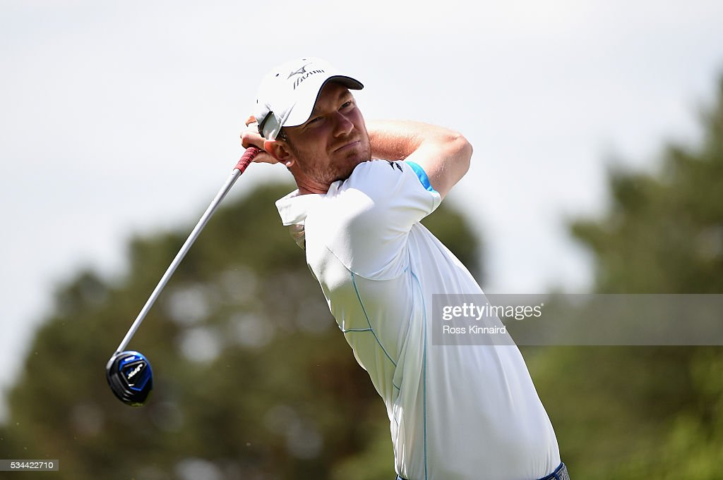 <a gi-track='captionPersonalityLinkClicked' href=/galleries/search?phrase=Chris+Wood+-+Golfer&family=editorial&specificpeople=4601133 ng-click='$event.stopPropagation()'>Chris Wood</a> of England tees off on the 15th hole during day one of the BMW PGA Championship at Wentworth on May 26, 2016 in Virginia Water, England.