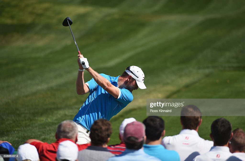Chris Wood of England tees off on the 1st hole during the final round of the Omega Dubai Desert Classic at the Emirates Golf Club on February 7, 2016 in Dubai, United Arab Emirates.