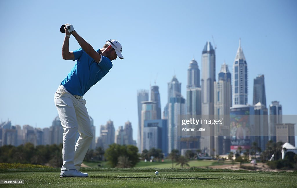 <a gi-track='captionPersonalityLinkClicked' href=/galleries/search?phrase=Chris+Wood+-+Golfer&family=editorial&specificpeople=4601133 ng-click='$event.stopPropagation()'>Chris Wood</a> of England tees off on the 8th hole during the final round of the Omega Dubai Desert Classic at the Emirates Golf Club on February 7, 2016 in Dubai, United Arab Emirates.