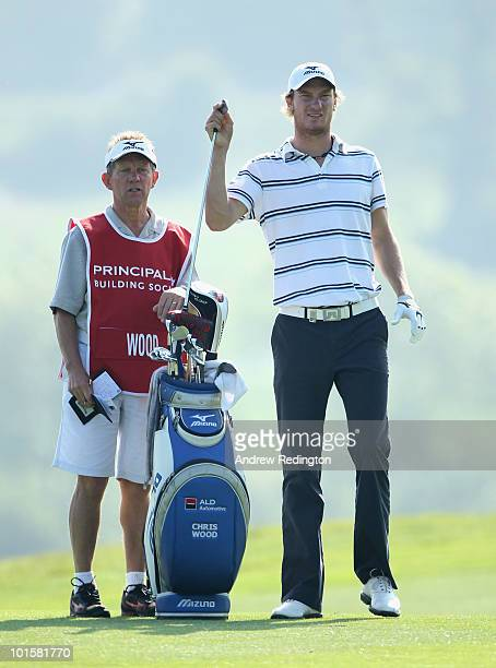 Chris Wood of England waits with his caddie Dave McNeilly on the 16th hole during the first round of the Celtic Manor Wales Open on The Twenty Ten...