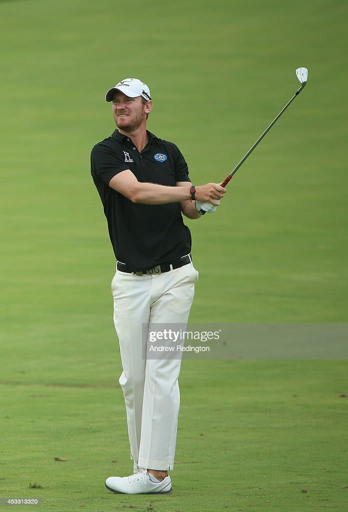 Chris Wood of England watches his approach shot on the ninth hole during the first round of the 96th PGA Championship at Valhalla Golf Club on August 7, 2014 in Louisville, Kentucky.