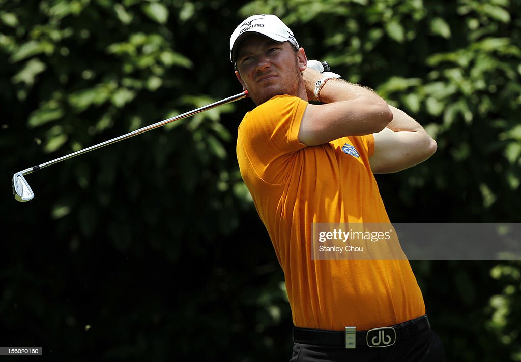 Chris Wood of England watches his tee shot on the 3rd hole during the fourth round of the Barclays Singapore Open at the Sentosa Golf Club on November 11, 2012 in Singapore.