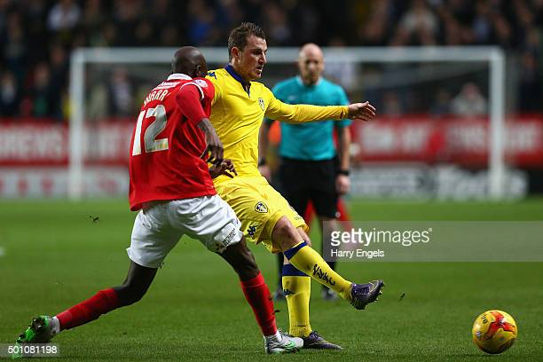 Chris Wood of Leeds passes the ball under pressure from Alou Diarra of Charlton during the Sky Bet Championship match between Charlton Athletic and...
