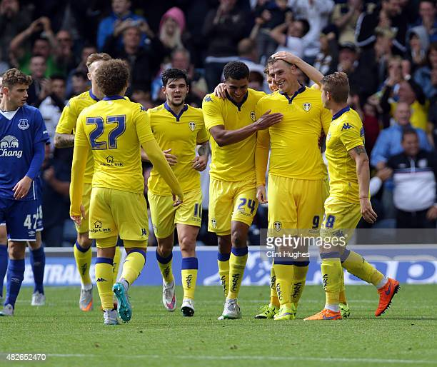 Chris Wood of Leeds United celebrates with his teammates after he scores the second goal for his side during the Pre Season Friendly match between...