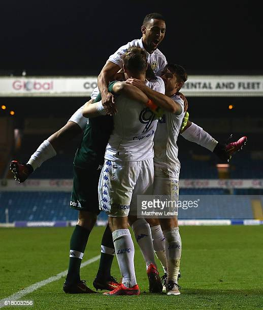 Chris Wood of Leeds United congratulates Marco Silvestri after they won on penalties during the EFL Cup Fourth Round match between Leeds United and...