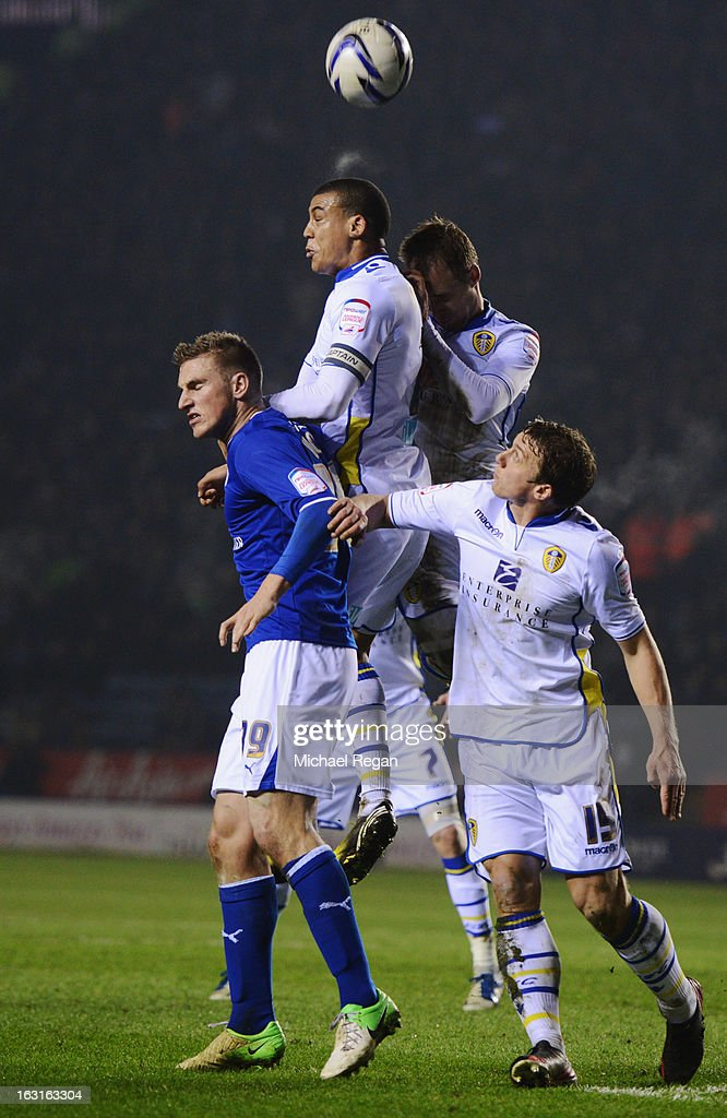 Chris Wood of Leicester City is foiled by <a gi-track='captionPersonalityLinkClicked' href=/galleries/search?phrase=Lee+Peltier&family=editorial&specificpeople=1007594 ng-click='$event.stopPropagation()'>Lee Peltier</a>, Luke Varney and <a gi-track='captionPersonalityLinkClicked' href=/galleries/search?phrase=Stephen+Warnock&family=editorial&specificpeople=224415 ng-click='$event.stopPropagation()'>Stephen Warnock</a> of Leeds United during the npower Championship match between Leicester City and Leeds United at The King Power Stadium on March 5, 2013 in Leicester, England.