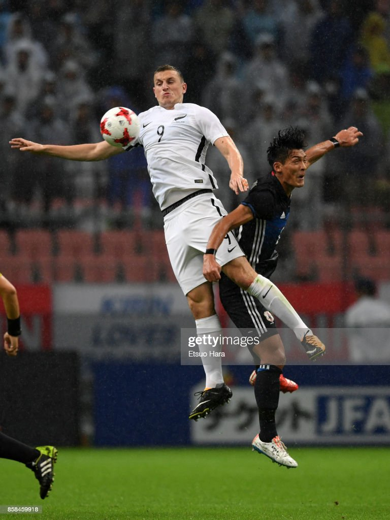 Chris Wood of New Zealand and Tomoaki Makino of Japan compete for the ball during the international friendly match between Japan and New Zealand at Toyota Stadium on October 6, 2017 in Toyota, Aichi, Japan.