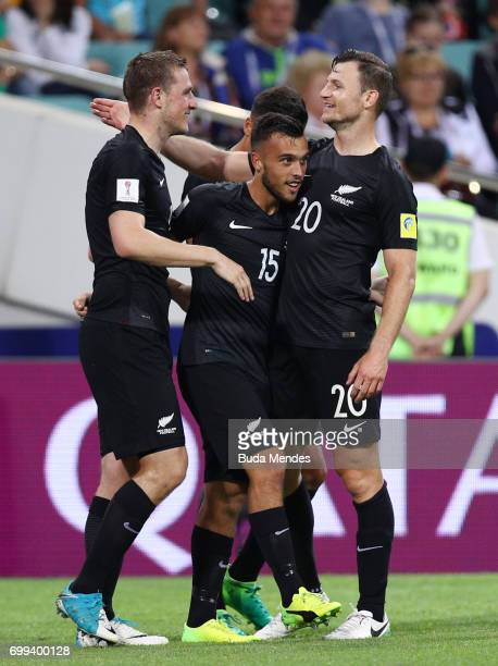 Chris Wood of New Zealand celebrates scoring his sides first goal with Clayton Lewis of New Zealand and Tommy Smith of New Zealand during the FIFA...