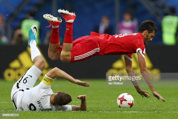 Chris Wood of New Zealand tackles Aleksandr Erokhin of Russia during the FIFA Confederations Cup Russia 2017 Group A match between Russia and New...