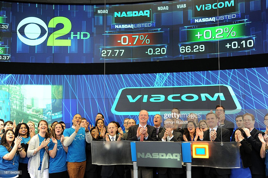 Chris Wood of Sea Bright Rising, Viacom President & CEO Philippe Dauman, Sea Bright Mayor Dina Long and EVP of NASDAQ Bruce Aust accompanied by Viacommunity Day Volunteers ring the NASDAQ Stock Market opening bell in honor of Viacommunity Day at the NASDAQ MarketSite on April 22, 2013 in New York City.