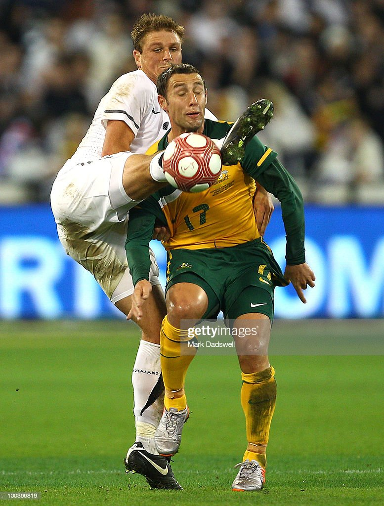 Chris Wood of the All Whites gets his boot to the ball ahead of Scott McDonald of the Socceroos during the 2010 FIFA World Cup Pre-Tournament match between the Australian Socceroos and the New Zealand All Whites at Melbourne Cricket Ground on May 24, 2010 in Melbourne, Australia.