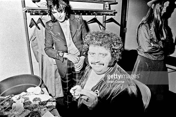 Chris Wood of Traffic backstage with sound engineer Jimmy Johnson during a European tour with the Muscle Shoals rhythm section on 28th March 1973