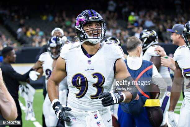Chris Wormley of the Baltimore Ravens smiles while jogging off the field during a preseason game against the New Orleans Saints at MercedesBenz...