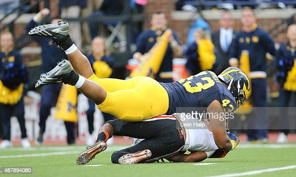 Chris Wormley of the Michigan Wolverines sacks quarterback Marcus McMaryion of the Oregon State Beavers during the fourth quarter of the game on...