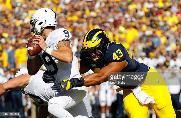 Chris Wormley of the Michigan Wolverines sacks quarterback Trace McSorley of the Penn State Nittany Lions during the first quarter of the game at...