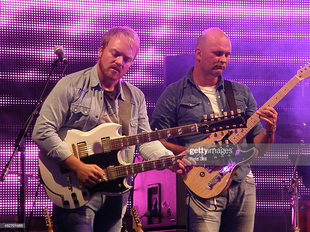 Chris Wright and Christian Phillips of The Eagles tribute band Ultimate Eagles perform on stage at Silverstone Classic at Silverstone on July 25, 2014 in Northampton, United Kingdom.
