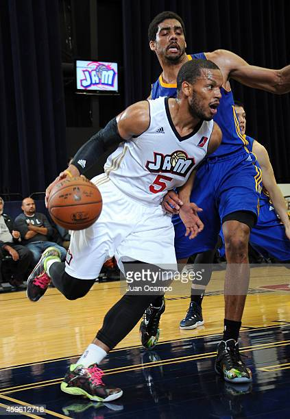Chris Wright of the Bakersfield Jam drives the baseline against James Michael McAdoo of the Santa Cruz Warriors during a DLeague game on November 25...